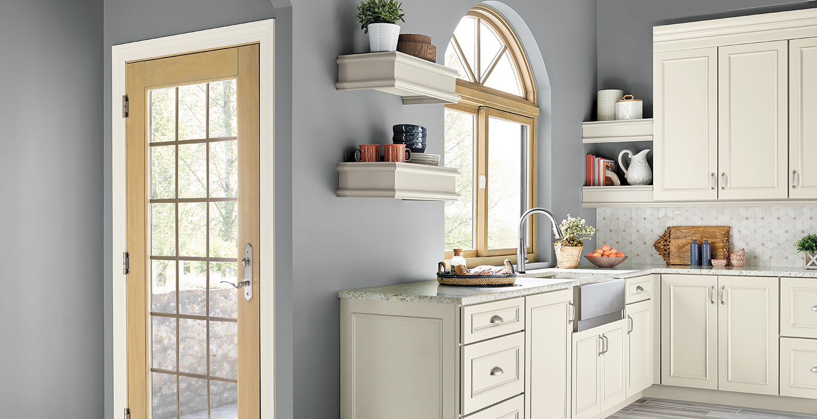 Traditional styled kitchen with blue gray on walls, white on cabinets, and granite counter tops